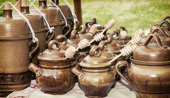 Clay pots with honey dippers Stock Photos
