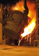 Steel factory, cast iron smelting, sparks flying Stock Photos