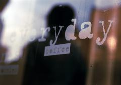 Everyday, coffee text on shop window,  close-up - stock photo