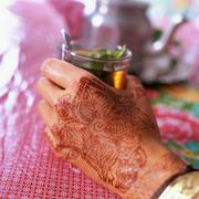 Henna tattoo on woman's hand Stock Photos