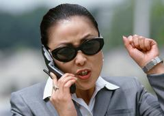 Businesswoman speaking on cell phone, aggressively gesturing Stock Photos