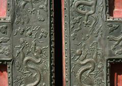 China, Beijing, Forbidden City, dragon motif metalwork on door - stock photo