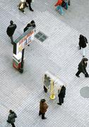 China, Liaoning, Dalian, pedestrians walking across esplanade, people using - stock photo