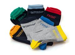 Isolated funny wool socks with days inscriptions Stock Photos