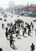 Stock Photo of China, Beijing, bicycle traffic stopped at intersection