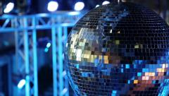Blue spinning glitterball on dancefloor Stock Footage