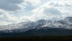 Stock Footage Time Lapse Snowy Mountains in Stormy Weather Stock Footage