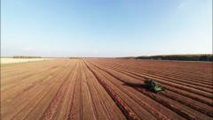 Aerial Stock Footage Agricultural field and Harvester Stock Footage