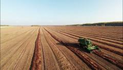 Aerial Stock Footage Agricultural field and Harvester Combine Stock Footage