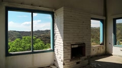 Beautiful landscape out of wide window of an abandoned hotel Stock Footage