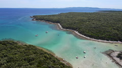 Aerial - Flight over beautiful bay with crystal clear water and white sand Stock Footage