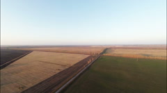Stock Footage Aerial Sunset View of Agricultural fields Stock Footage