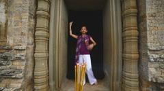 Buddhist Praying / Worshiping at Angkor Wat Temple Cambodia Stock Footage