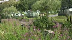Mobile home residential caravan park with pond in wales, uk Stock Footage