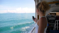 Woman Using Mobile Phone on Ferry Board. Slow Motion. Stock Footage