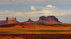 Monument Valley Sunset 10 Timelapse Clouds  Highway USA Stock Footage