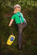 Child climb on the hill - stock photo