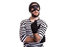 Crafty criminal inviting with hand. Portrait isolated on white background - stock photo