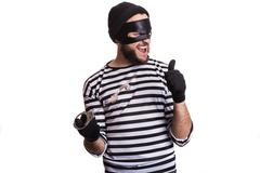 Thief escape from a jail. Portrait isolated on white background - stock photo