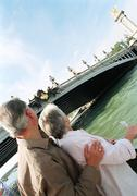 France, Paris, mature woman and man looking at the Pont Alexandre III Stock Photos