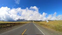 POV driving Mountain road Mt Mauna Kea vehicle Big Island Hawaii USA Stock Footage
