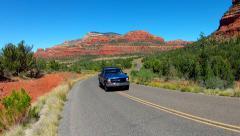 Pickup Truck Approaches Camera On Road Near Bear Mountain- Sedona Stock Footage