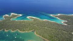Aerial - White sand beaches with clear blue water. Boats anchored in a bay Stock Footage