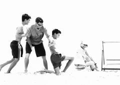 Family playing on beach, b&w Stock Photos