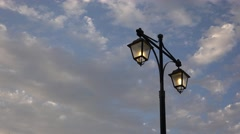 4K Lighting Lamppost, Timelapse Streetlight Sunset, Urban Lamplight, Cloudy Sky Stock Footage