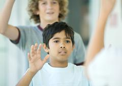 Preteen boys waving - stock photo