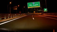 Driving on highway/interstate at night,  exit sign of the city of st. luis, m Stock Footage
