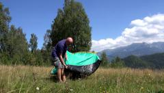 Father Setting Tent, Child Playing in Mountains, Happy Family at Camping Trip 4K - stock footage