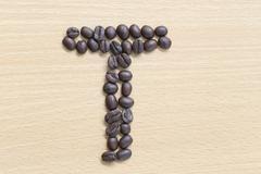 coffee beans of alphabet. - stock photo