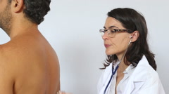 Femal doctor with stethoscope examine patient Stock Footage
