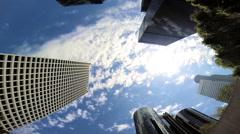 Skyscrapers office blocks blue sky clouds Urban scene Los Angeles - stock footage