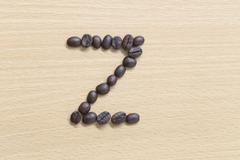 Coffee beans of alphabet. Stock Photos