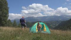 Father Setting a Tent, Child Playing in Mountains, Happy Family at Camping, Trip - stock footage