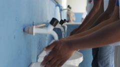 Kids washing hands at public school in Rio de Janeiro Stock Footage