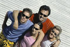 Family with two children standing together smiling at camera, high angle view Stock Photos