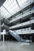 Escalator in atrium - stock photo