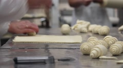 Bakers making croissants, close up Stock Footage