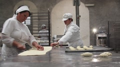 Bakers making croissants Stock Footage