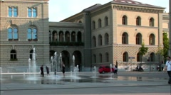 Unidentified girls dancing at a fountain near the Federal Palace of Switzerland Stock Footage