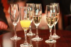 Champagne flutes with champagne and bucks fizz Stock Photos