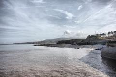 Moody clouds over the somerset coast at watchet Stock Photos