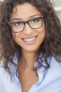 mixed race latina woman girl wearing glasses - stock photo