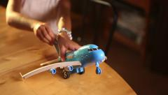 Little girl playing with airplane toy taking off Stock Footage
