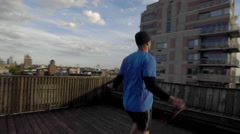 Athlete Jumping Rope Jumprope Exercise Fitness Skyline Health 4K Rooftop NYC - stock footage