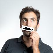 funny guy with fake moustache - stock photo
