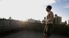 Athlete Jumping Rope Jumprope Exercise Fitness Wellness Health 4K Rooftop NYC Stock Footage